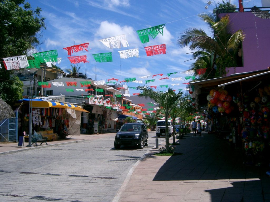 The main stretch of shops in Puerto Escondido, with the beach behind it.